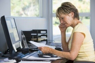 bigstock-Woman-In-Home-Office-With-Comp-4133754-330x220