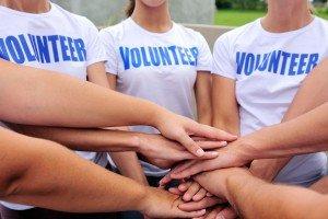 bigstock-volunteer-group-hands-together-bigger-e1433650508308-300x200